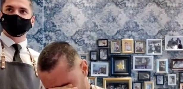 A barber shaves his hair in support of a friend with cancer