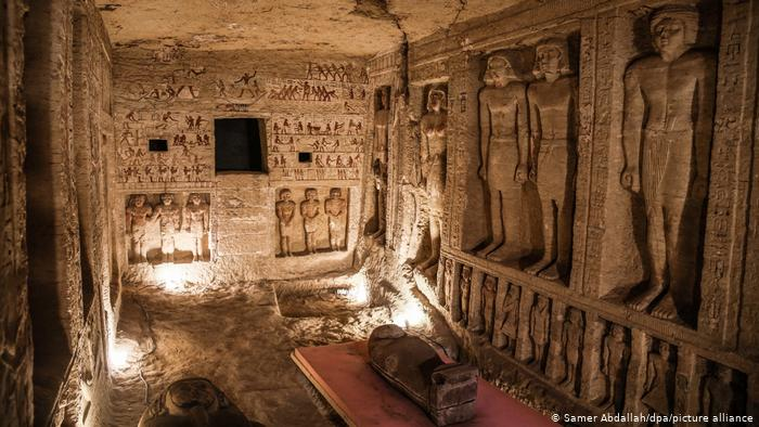 View of a tomb in Sakara, Egypt: wall decorations, paintings, and sarcophagi.