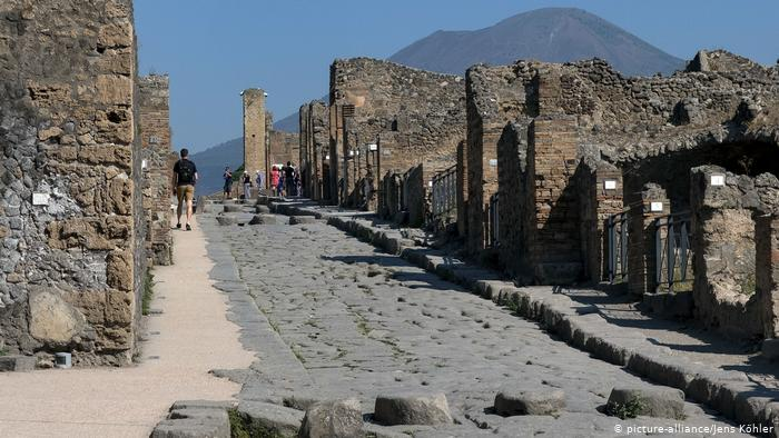 Ruins along a cobbled street in Pompeii Archaeological Park.