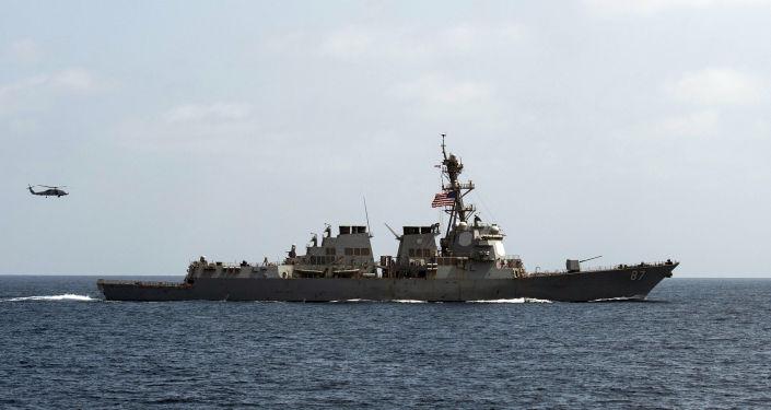 A US military ship fires 30 warning shots after meeting Iranian ships