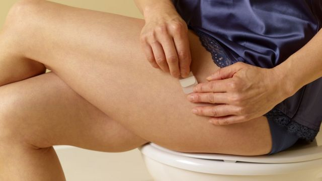 Hormone replacement therapy - a woman sticking a sticky substance on the skin
