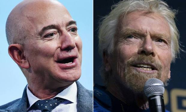 Billionaires Jeff Bezos (left) and Richard Branson (right) downplay a space dispute between them Image: AFP