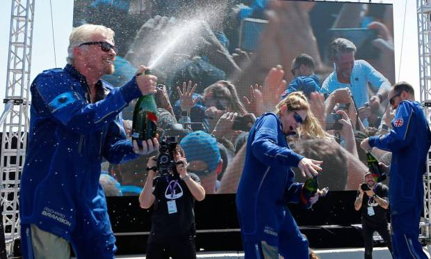 After landing, Richard Branson and his crew celebrated the successful launch Image: Joe Skipper/Reuters