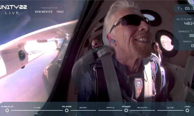 Aboard the VSS Unity spacecraft, upon reaching space, British billionaire Richard Branson smiled and celebrated the successful launch Image: Virgin Galactic/Via Reuters