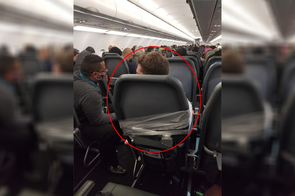 Flight attendants are removed after the deviant passenger is attached with duct tape