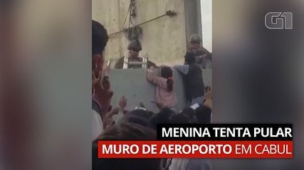 Video: A girl tries to jump off an airport wall in Kabul