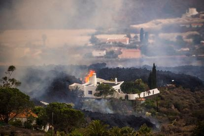 Lava swallows a house in El Paraíso on Monday.