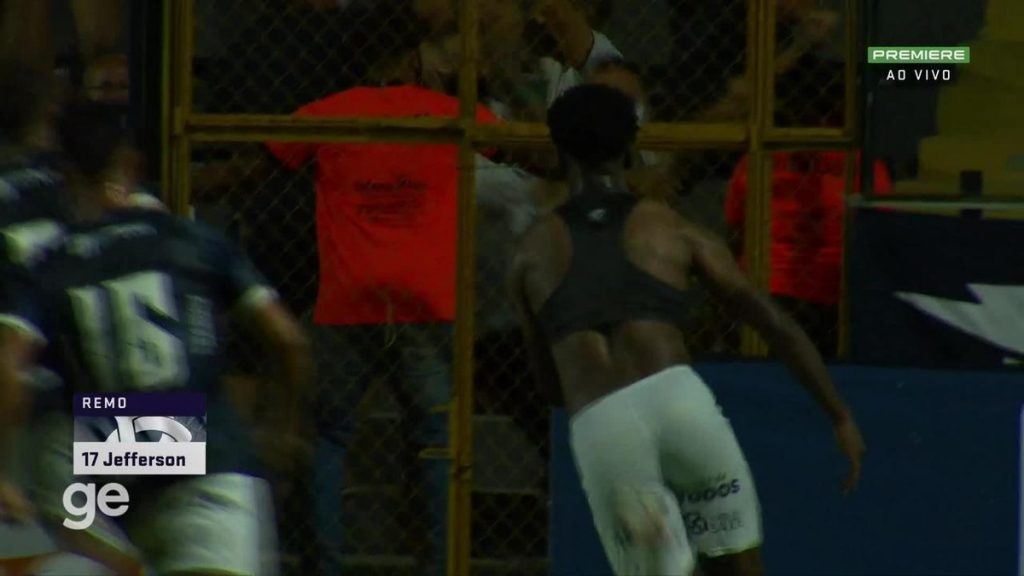 At the back of the crowd is a gate that does not support Remo's celebration after the winning goal in the end |  Rowing