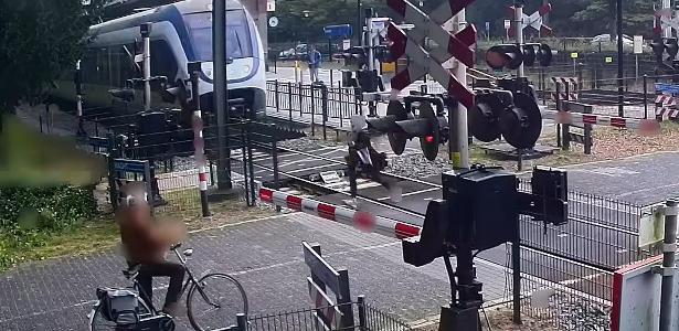 Woman running away from being crushed by train