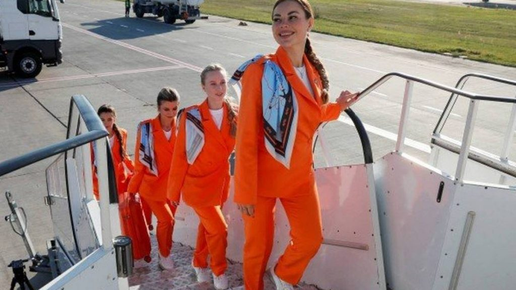 Ukrainian company incorporates sneakers and trousers into flight attendant uniforms |  who are they